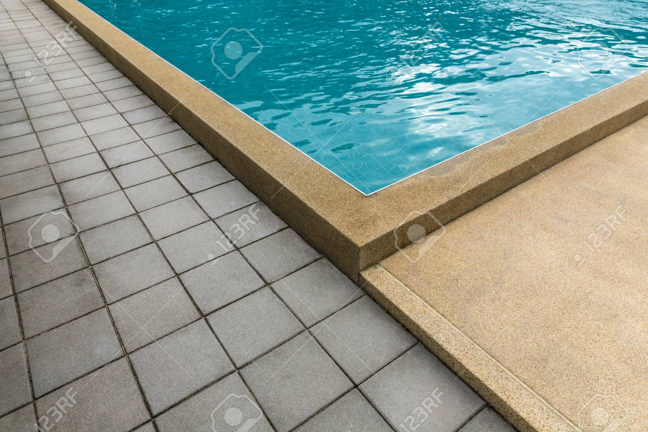 Swimming pool with cement blocks pathway and yellow polished..