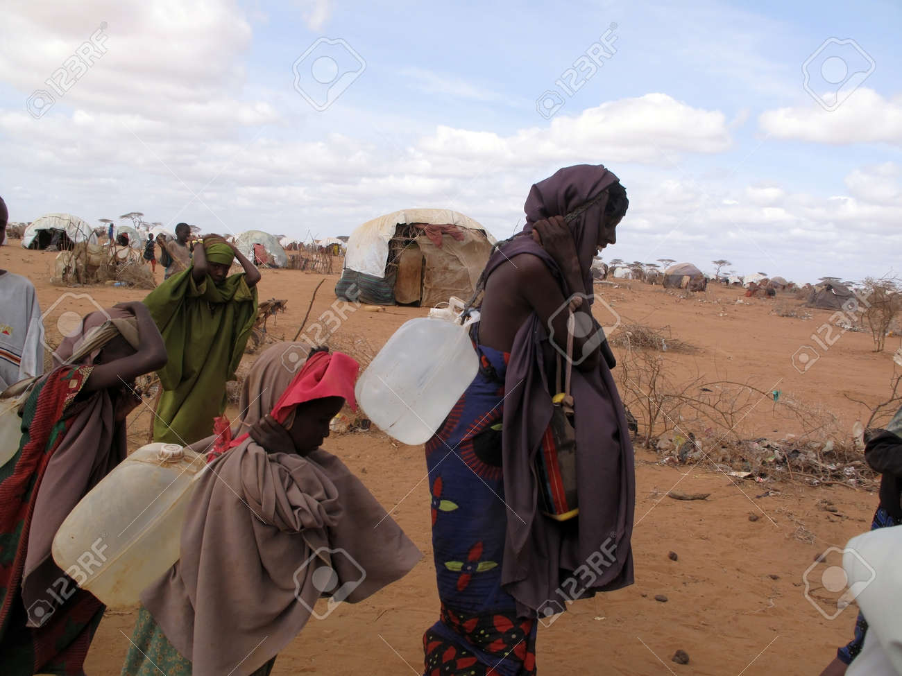 Woman and children live in the Dadaab refugee camp where thousands of Somalis wait for help because of hunger  in Dadaab, Somalia.                            Stock Photo - 16704657