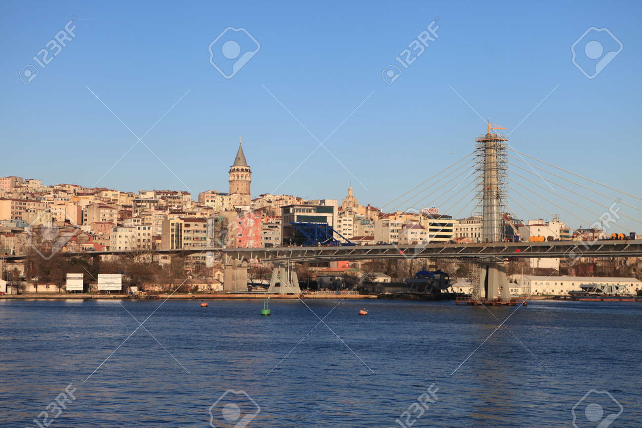 ISTANBUL, TURKEY- The ongoing construction of the Golden Horn Metro Bridge has been criticized for breaking city s skyline  in Istanbul,Turkey  Stock Photo - 18306352