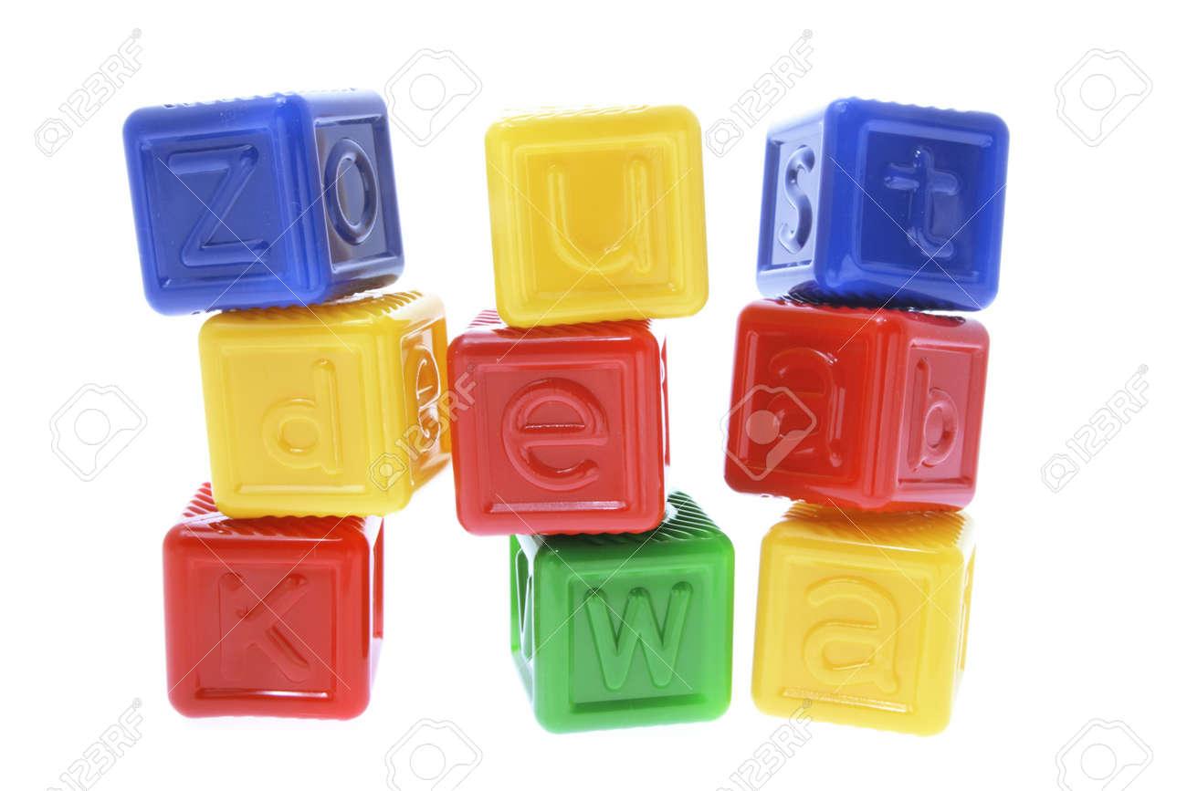 Stacks of Plastic Alphabet Cubes on White Background Stock Photo - 3533424