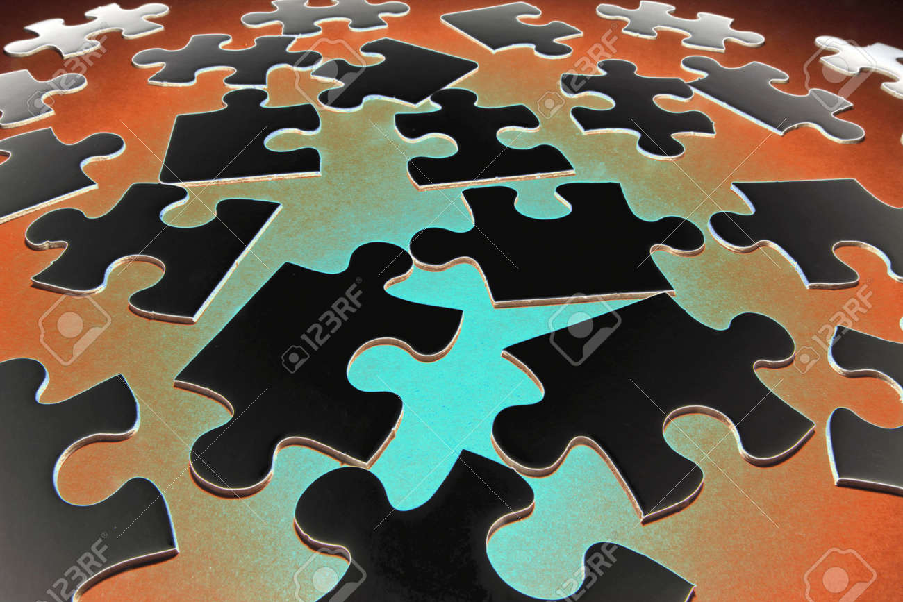Jigsaw Puzzle Pieces on Red and Green Background Stock Photo - 4665658