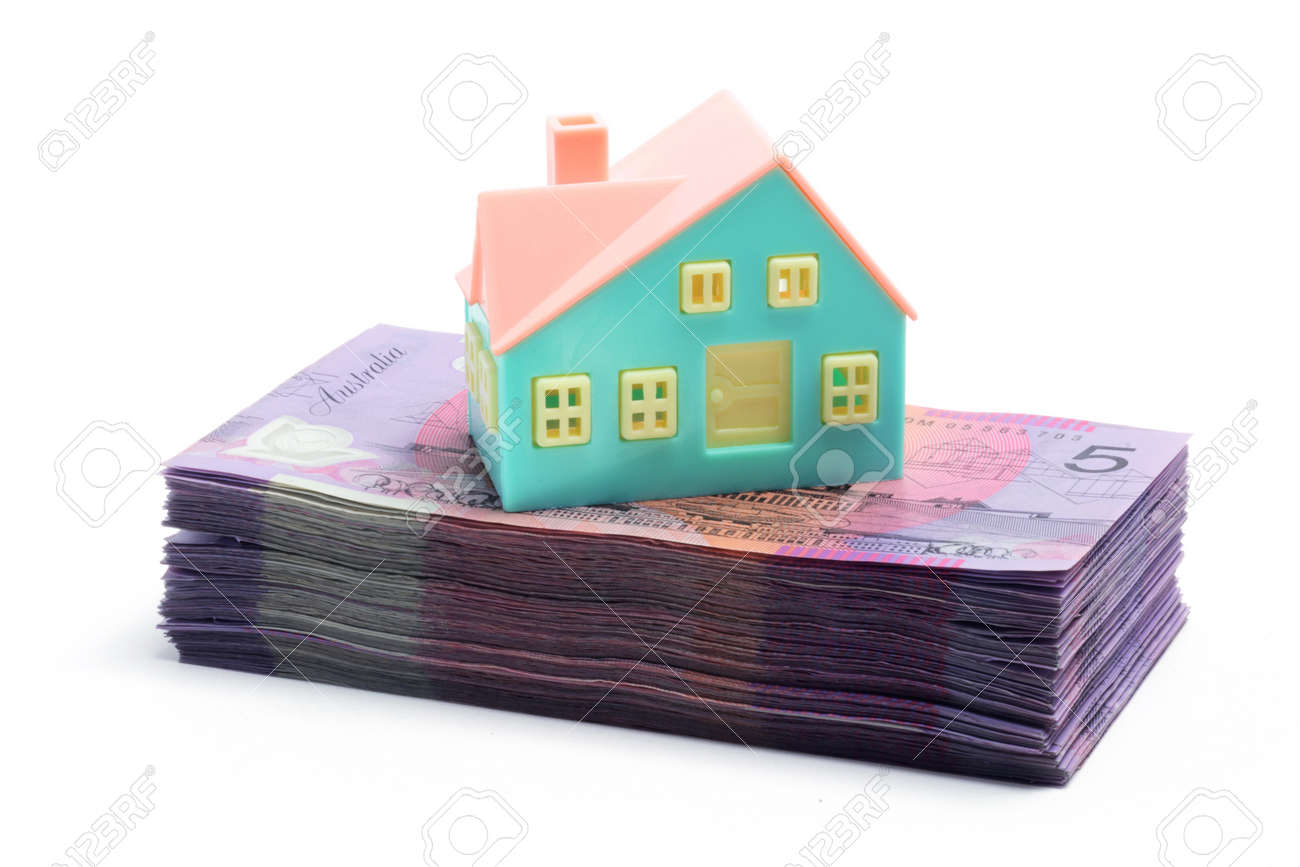 Stack of Notes with Miniature House on White Background Stock Photo - 7557717