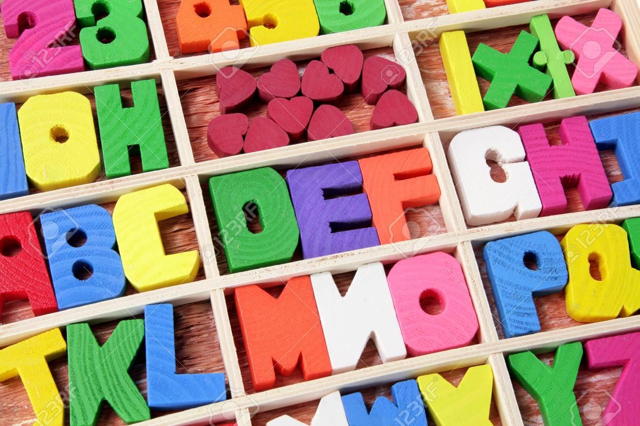 Wooden Alphabets on White Background Stock Photo - 10810299