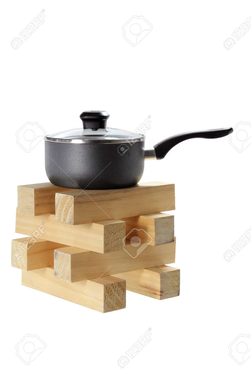 Pot on Stack of Wood on White Background Stock Photo - 17344134