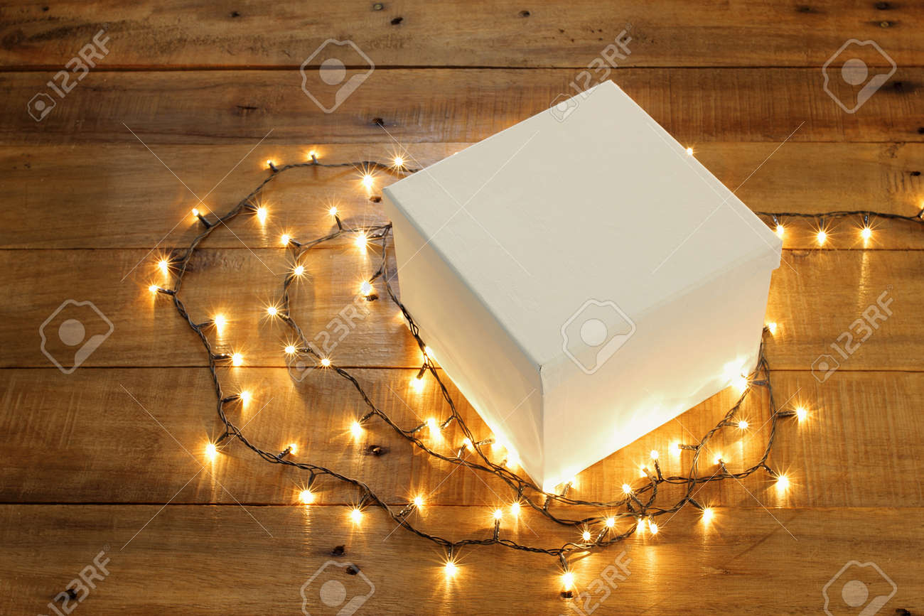 newest 6911a 08f23 Gift Box and Fairy Lights on Wooden Background