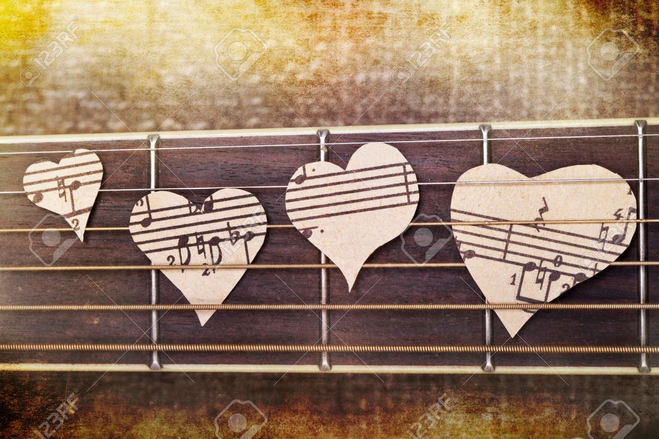 Popular Wallpaper Love Guitar - 41073837-guitar-and-musical-heart-background-wallpaper  2018_64165.jpg