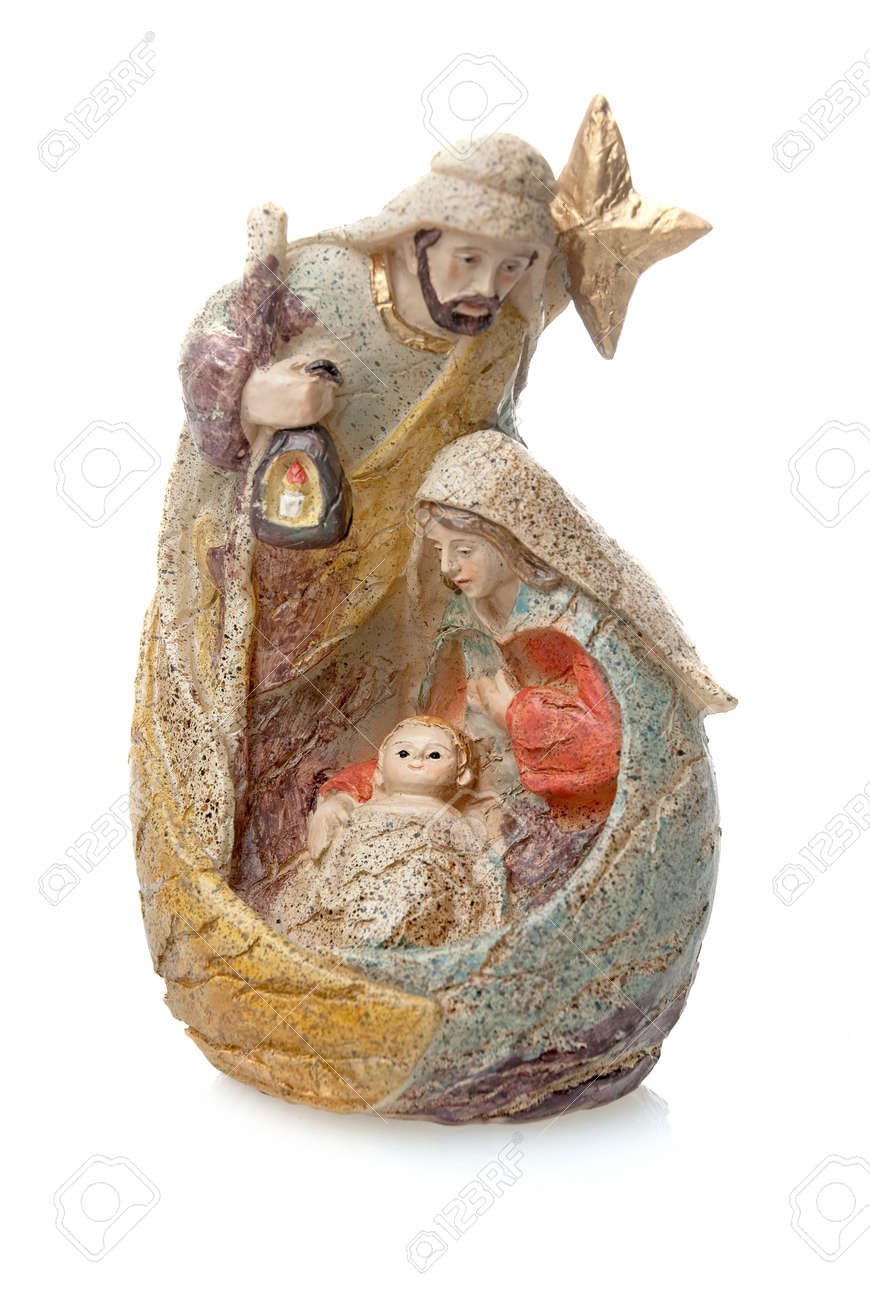 Christmas crib isolated on white statuettes representing Mary, Jesus and Joseph. Stock Photo - 8223329