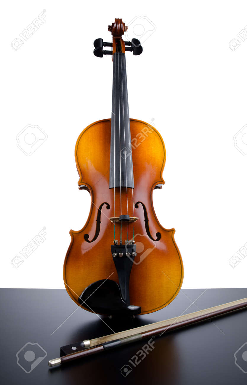 Violin on top of dark table partially isolated on white background. Stock Photo - 9901506