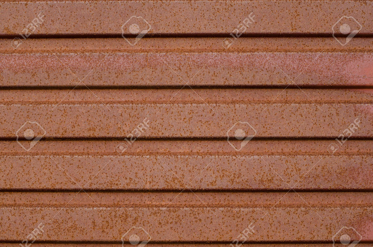 Rusted grunge corrugated metal background texture Stock Photo - 13904004