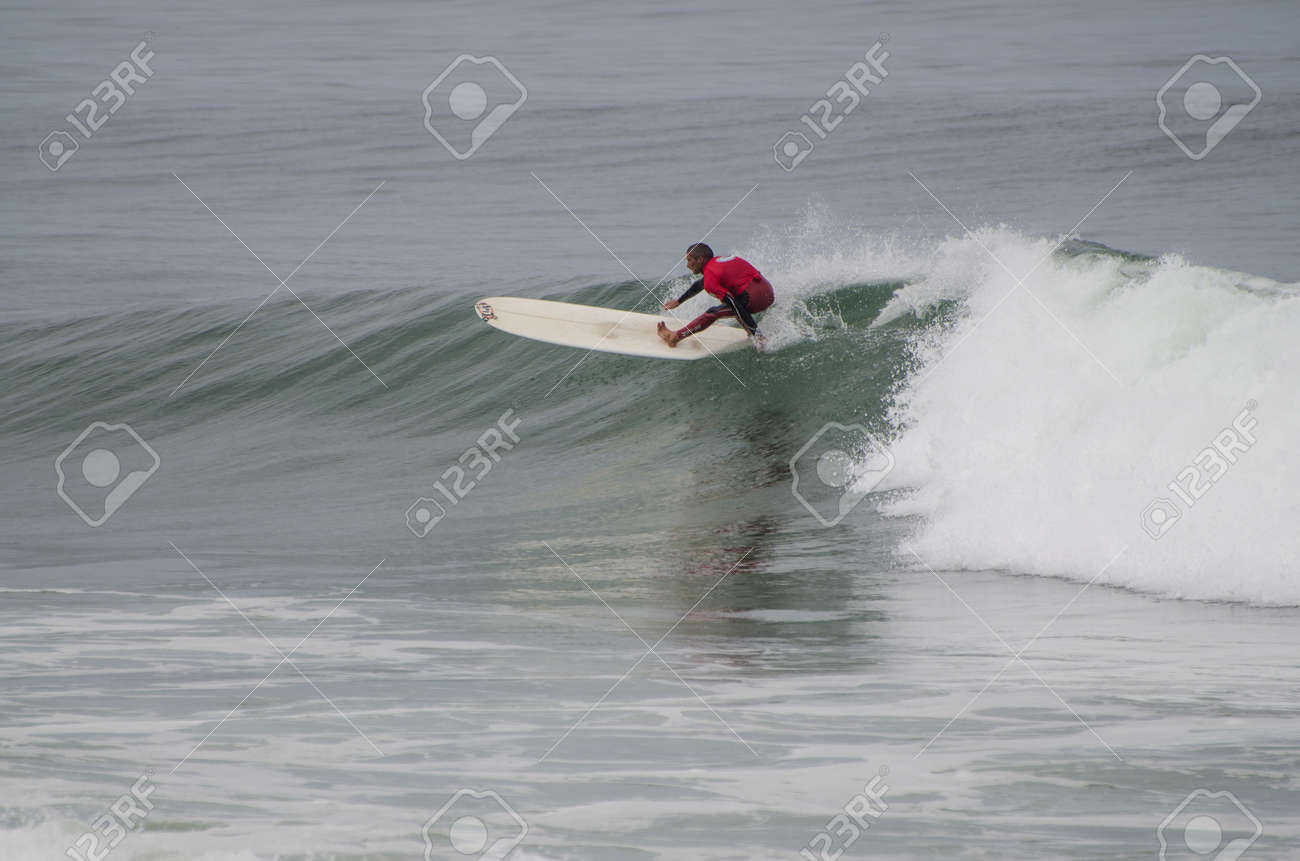 OVAR, PORTUGAL - AUGUST 19: Unidentified surfer at 1st stage of National Longboard Championship  on august 19, 2012 in Ovar, Portugal. Stock Photo - 14819051