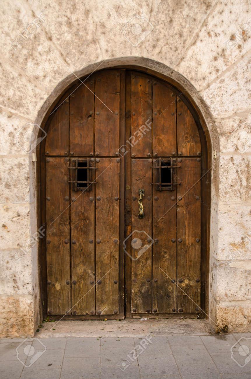 Old wooden door from medieval era. - 15581280