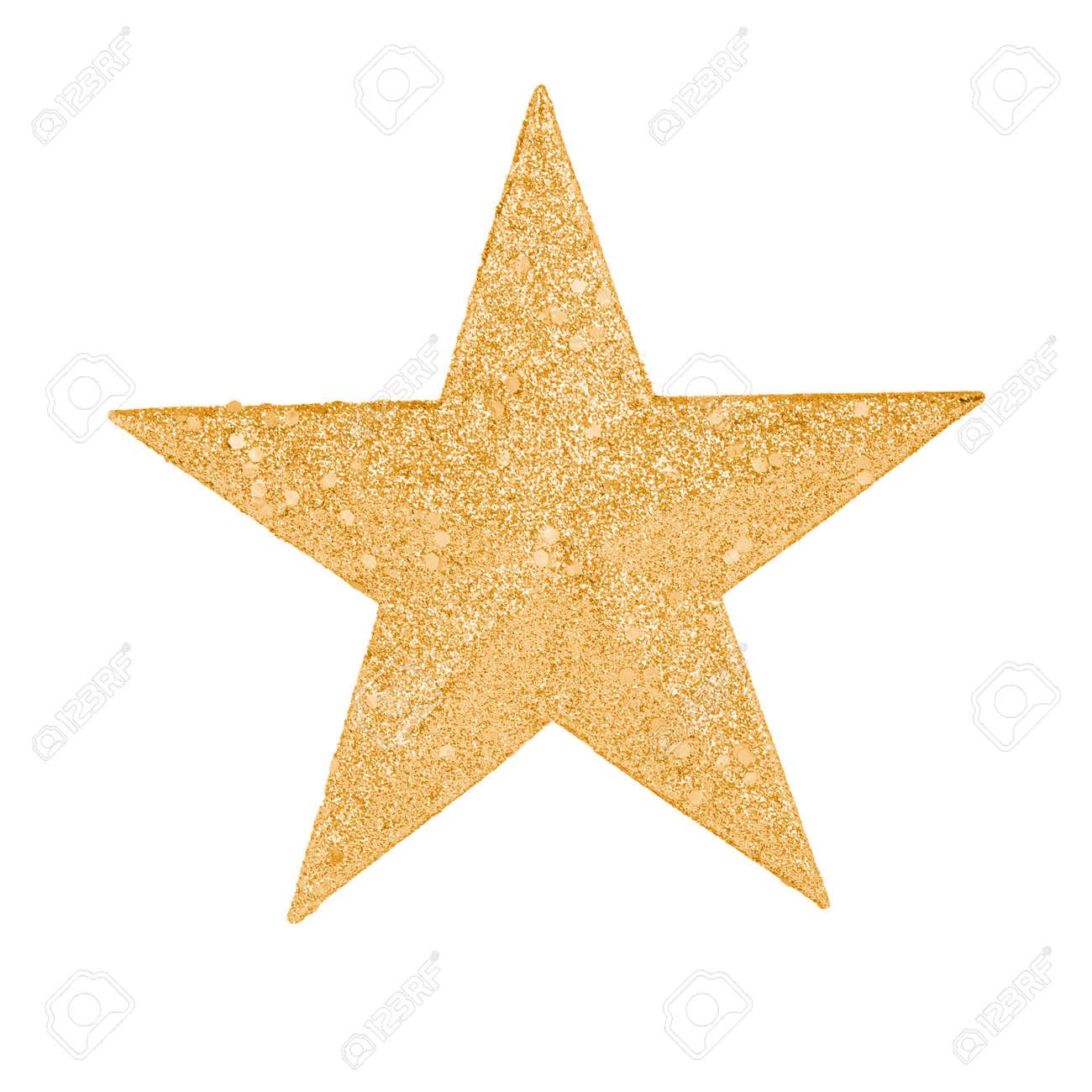 una estrella de oro para decorar un rbol de navidad foto de archivo