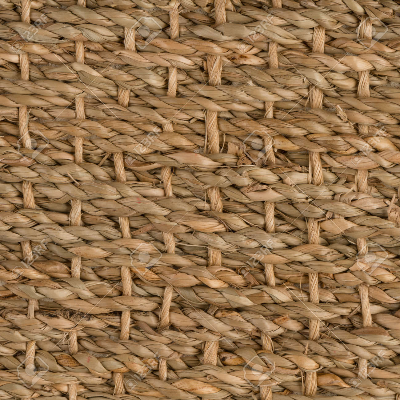 closeup detail of a brown sisal carpet texture background stock photo