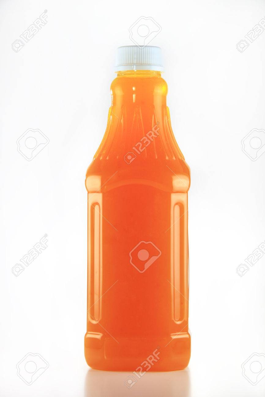 Orange color fruit concentration in transparent bottle with white cap Stock  Photo - 31528457