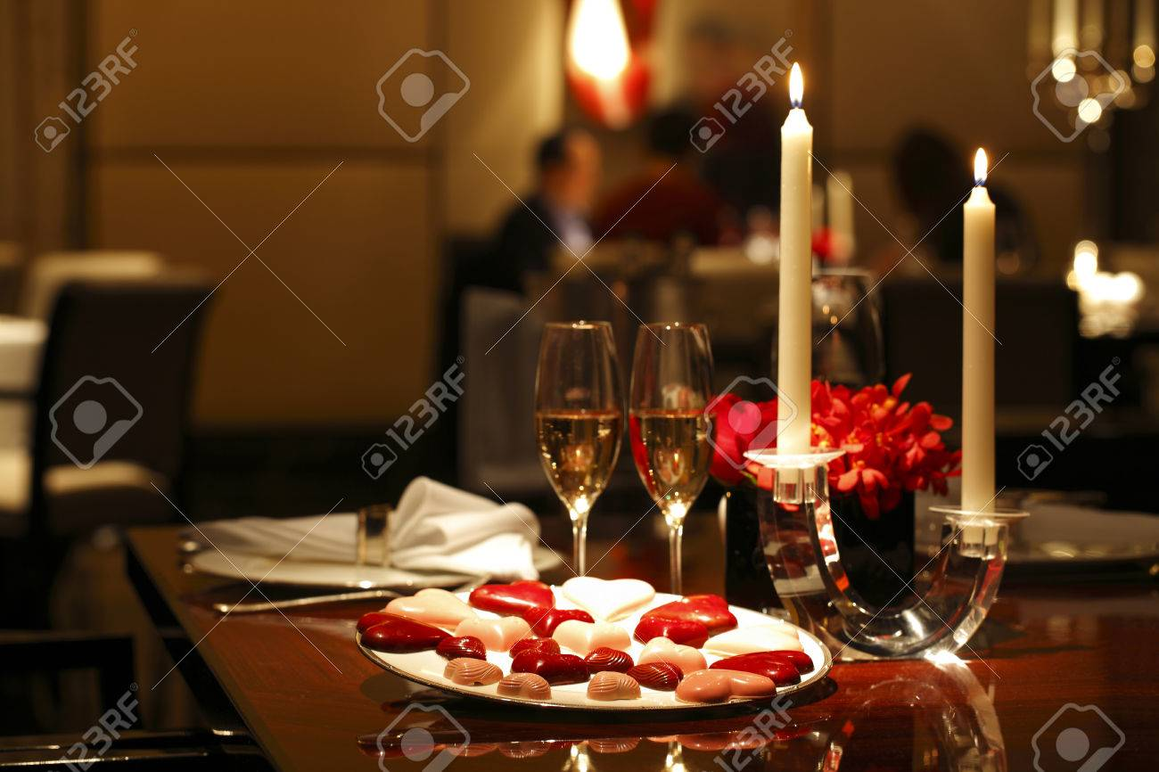 Romantic table setting with Chocolates Candle and Wine Stock Photo - 61684620 & Romantic Table Setting With Chocolates Candle And Wine Stock Photo ...