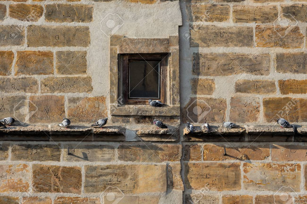 Old And Grunge Stone Wall Window Medieval Gothic Architecture Detail In Historic Prague