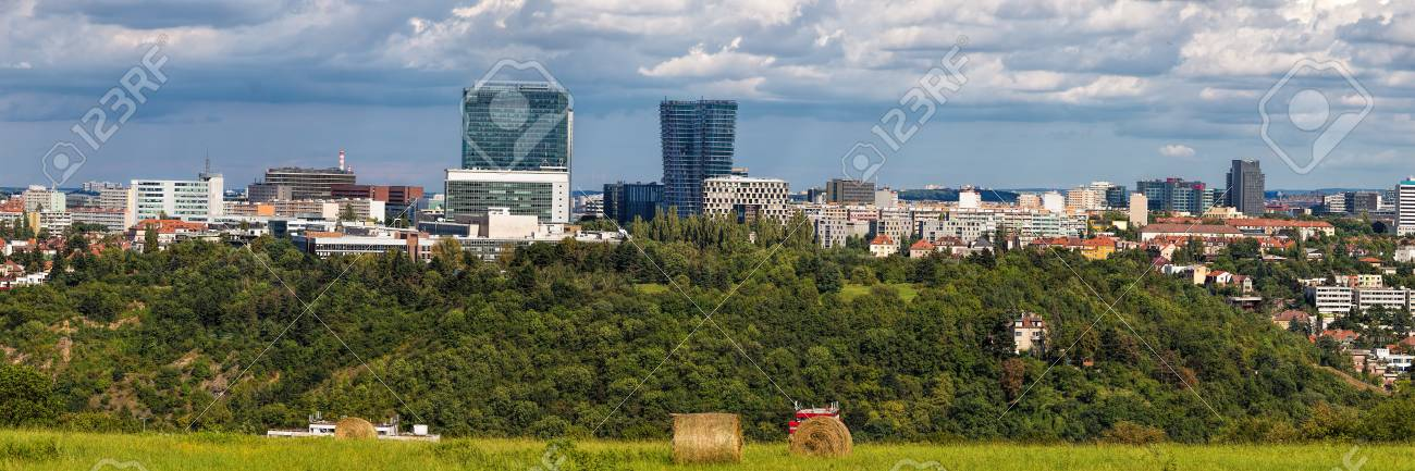 Wide panorama of Pankrac, Prague main business district with modern tall buildings, highest in Prague. Czech Republic, Europe. River Vltava is down in the valley. - 104890759