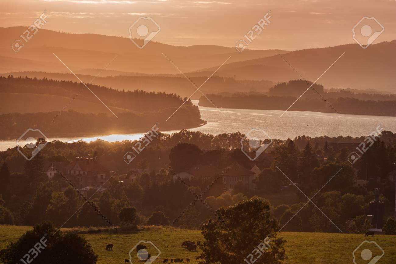 Colorful idyllic evening landscape at lake Lipno, Horni Plana, Czech mountains Sumava, Bohemian forest Bavarian Forest - 104890785