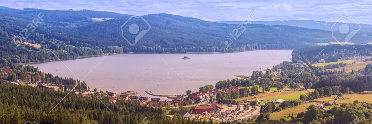 Panorama of Lake Lipno in south Bohemia, 200 km south of Prague, Czech Republic, Europe, aerial view. - 104890805