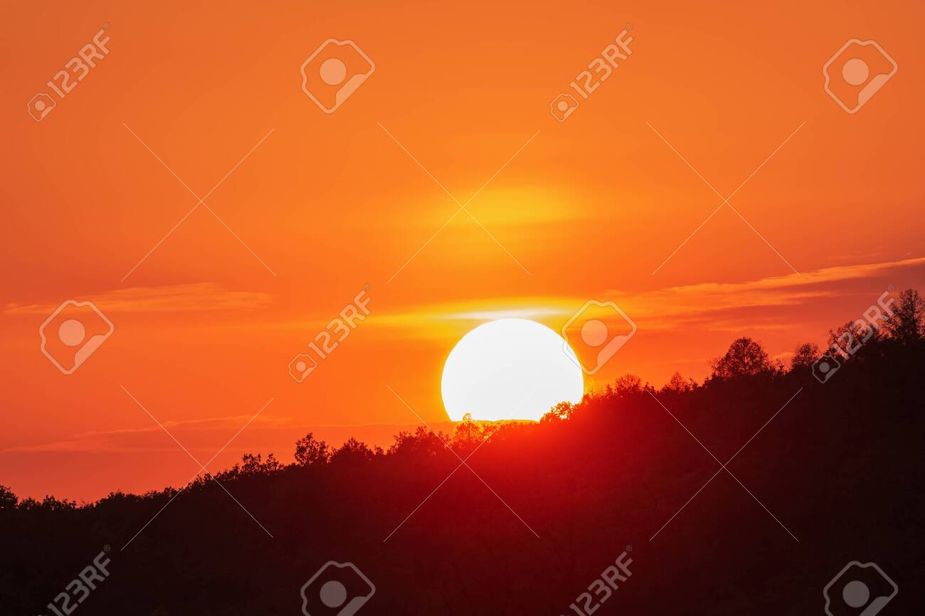 Colorful orange sky with sun at down, romantic background - 128379519