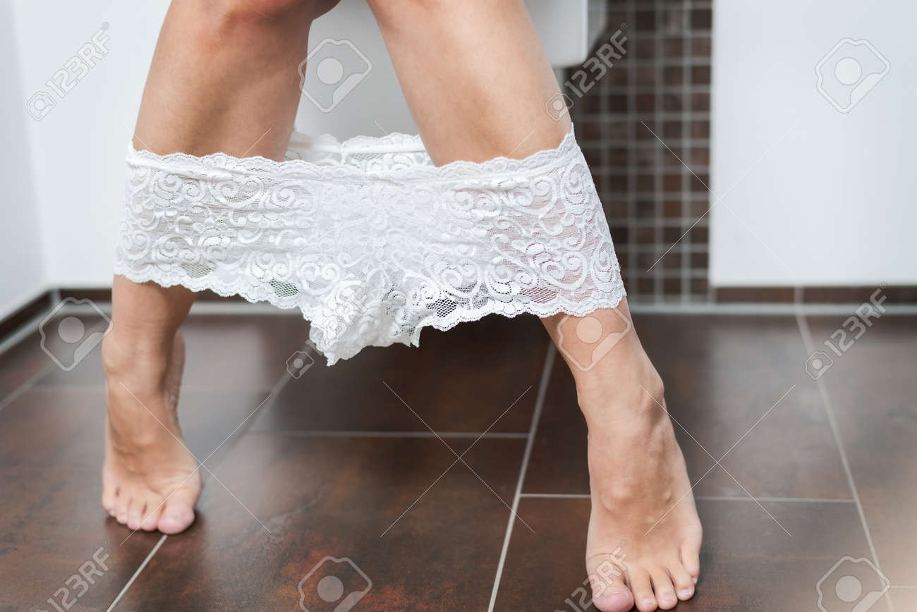 suggestive close up view of the bare legs and feet of a woman