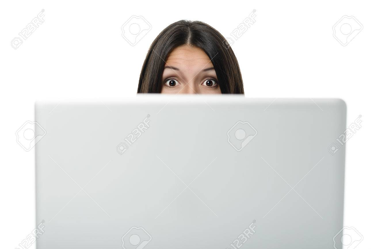 Businesswoman looking over the top of her computer screen at