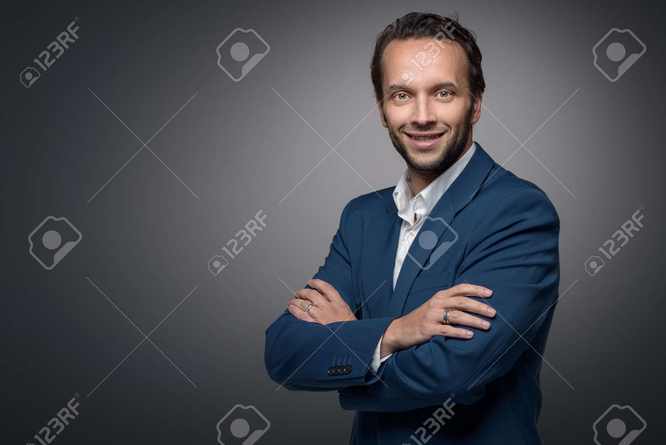 Handsome Stylish Businessman Standing With Crossed Arms Looking
