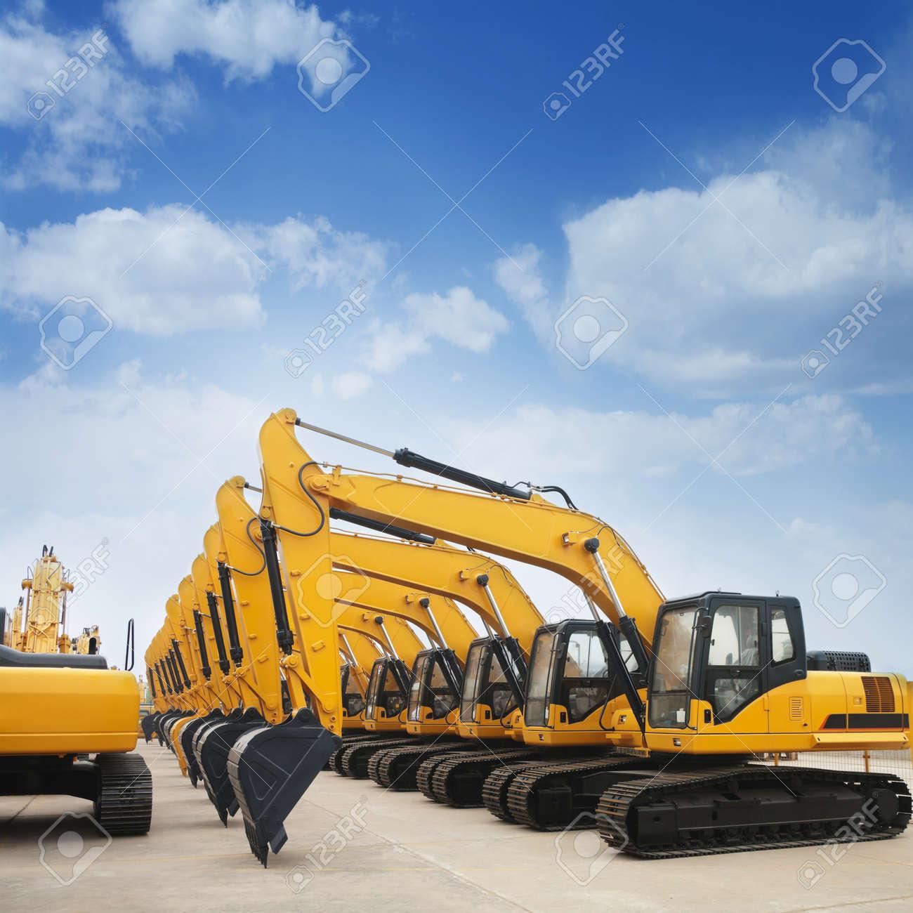 shiny and modern yellow excavator machines Stock Photo - 9757407