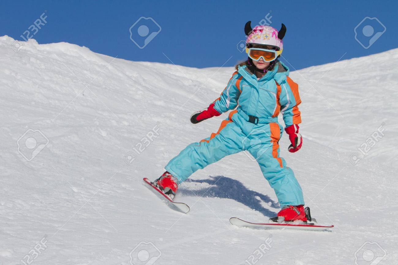 Little girl skiing downhill Stock Photo - 12470198