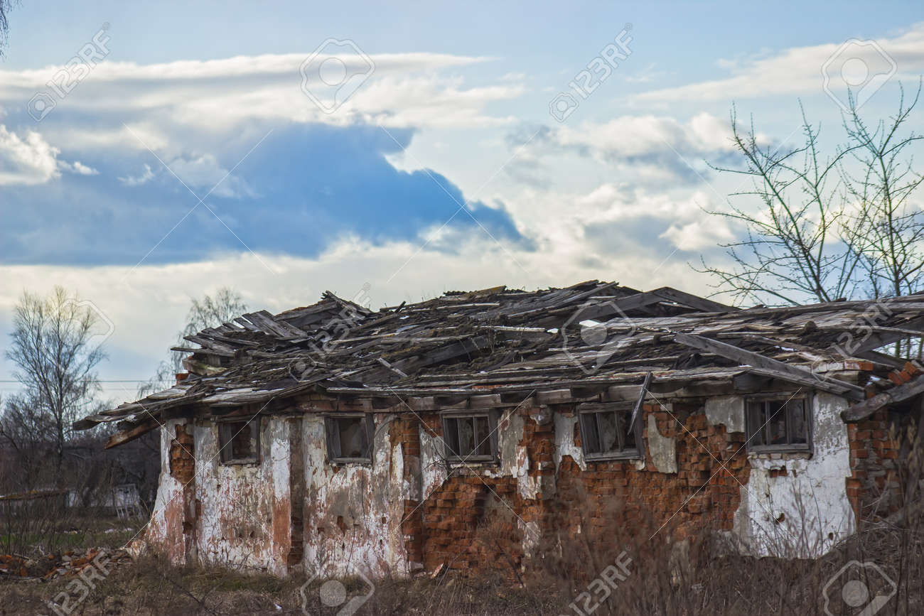 derelict and abandoned farmhouse on a stormy day