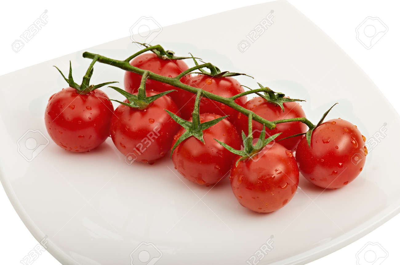 Cherry tomatoes on vine with water drops on white plate with light shadow Stock Photo - 12874206