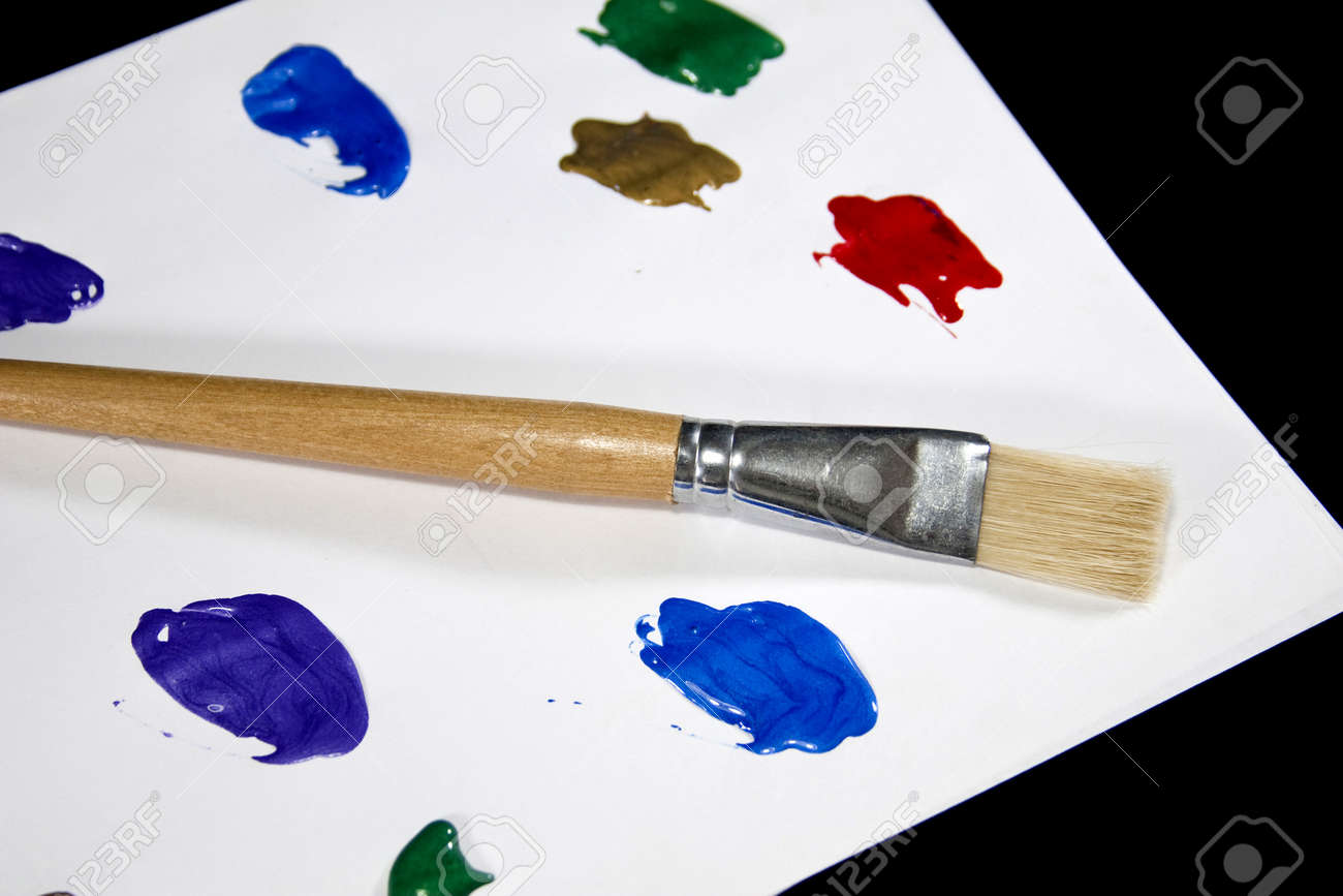 A paint brush and colorful paints create a painters palette. Stock Photo - 17923951