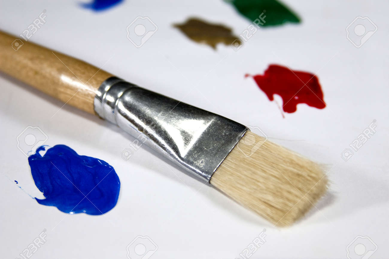 A paint brush and colorful paints create a painters palette. Stock Photo - 17923957