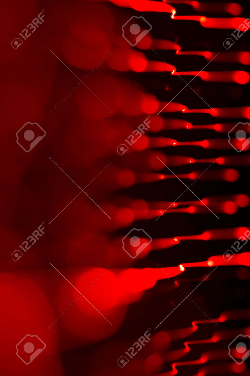 Dark overlay background of red LED lights with bokeh effect