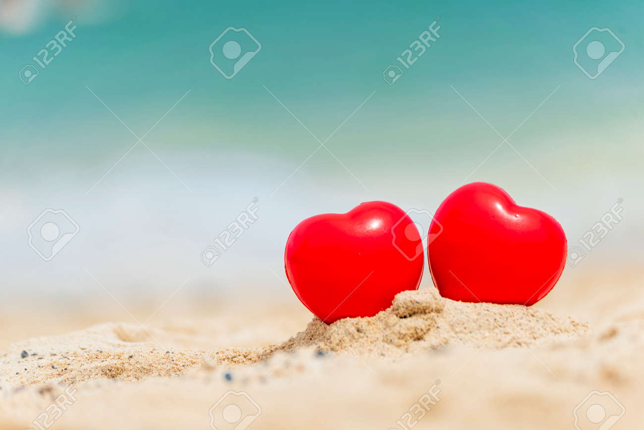 Two Hearts couple lover symbol on honeymoon day trip in tropical paradise island with banner copy space. Romantic red hearts objects on wedding anniversary for couple lover. Honeymoon tourism concept. - 146433674