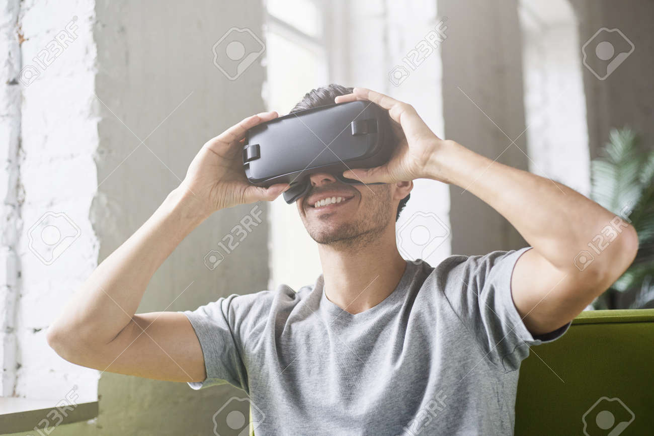 cd359945be6 Smiling Man Using Oculus Rift Headset
