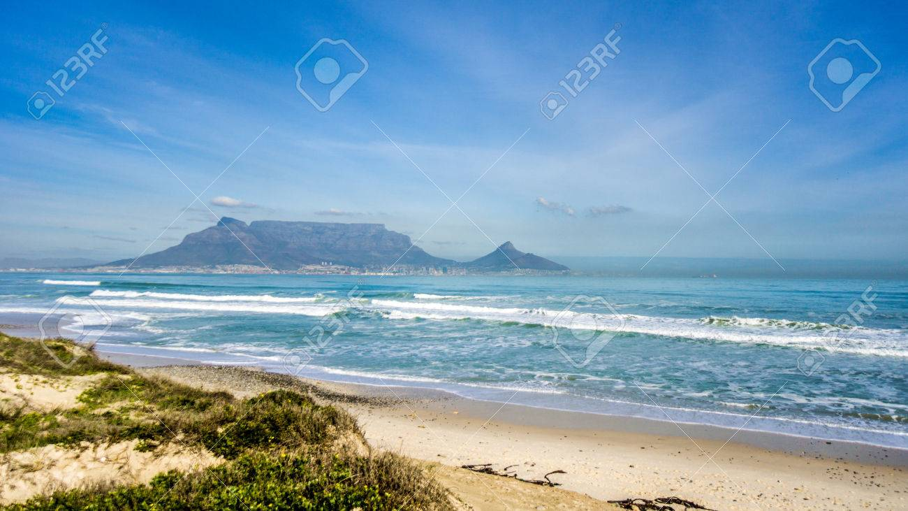 Early morning view of Cape Town and Table Mountain with Lion's Head and Signal Hill on the right and Devil's Peak on the left. Viewed from Bloubergstrand just north of the city - 84397103
