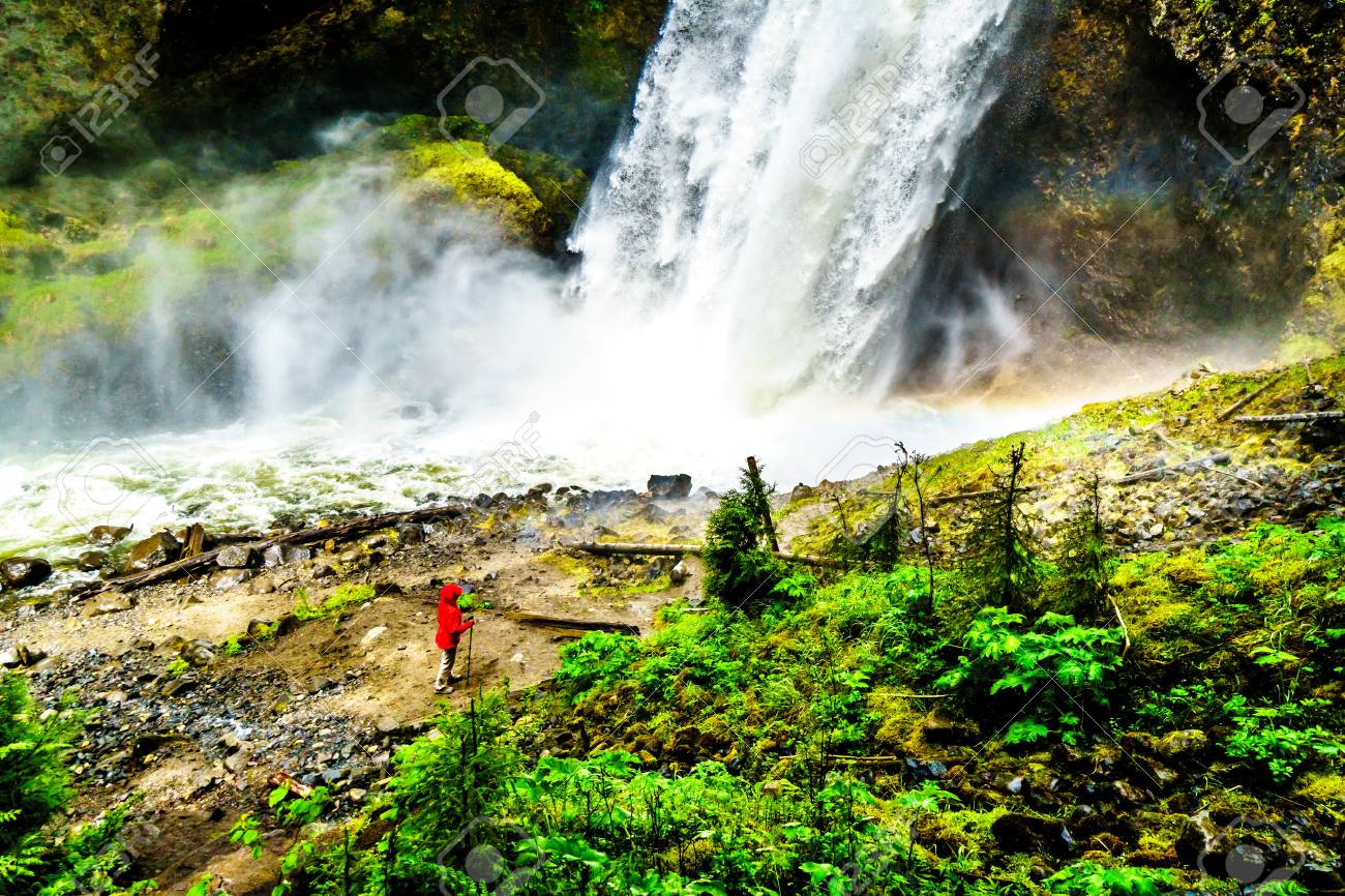 Woman In A Wind Breaker In The Mist At The Bottom Of Moul Falls