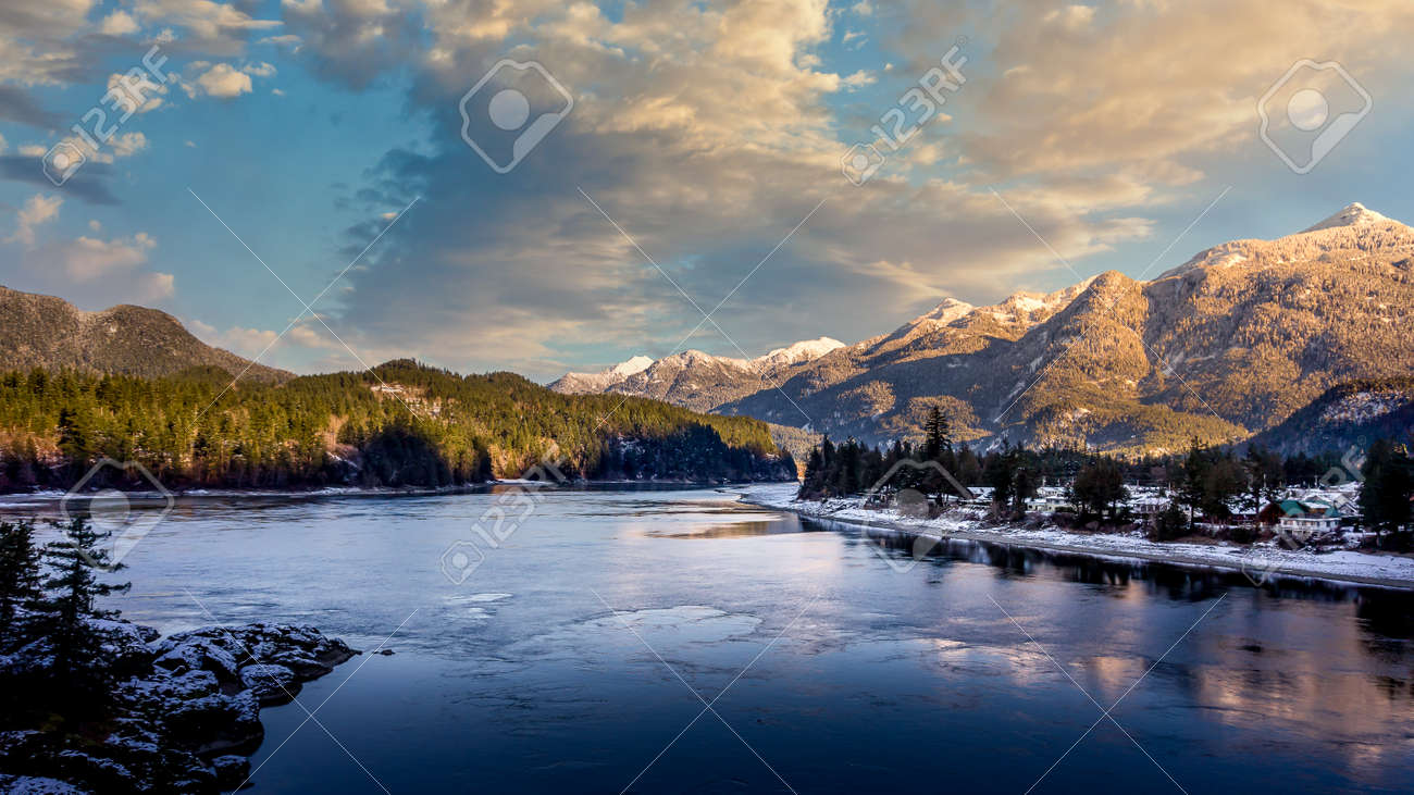 Partly ice covered Fraser River as it passes the town of Hope at the start of the Fraser Canyon Route in British Columbia, Canada - 156120899