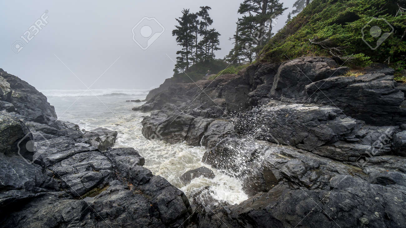Waves crashing into the Rocks at Cox Bay on a Foggy Day at the Pacific Rim National Park on the West Coast of Vancouver Island, British Columbia, Canada - 158291694