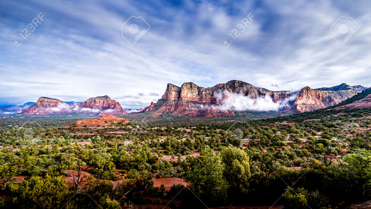 Low Cloud hanging around the Red Rocks of Munds Mountain and Twin Buttes after a heavy rainfall near the town of Sedona in northern Arizona in Coconino National Forest, USA - 159817632