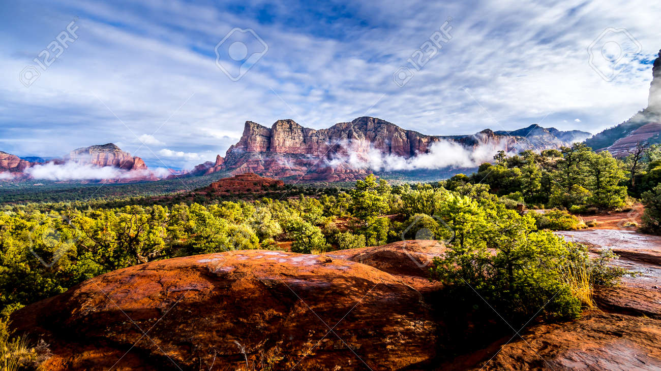 Low Cloud hanging around the Red Rocks of Munds Mountain and Twin Buttes after a heavy rainfall near the town of Sedona in northern Arizona in Coconino National Forest, USA - 159817645