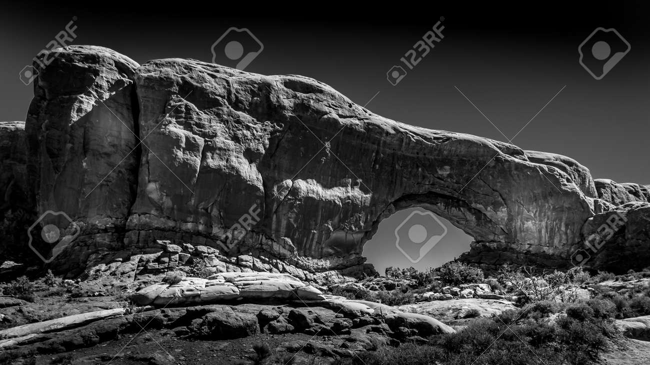 Black and White Photo of the North Window Arch, one of the many large Sandstone Arches in Arches National Park, Utah, United States - 163724490