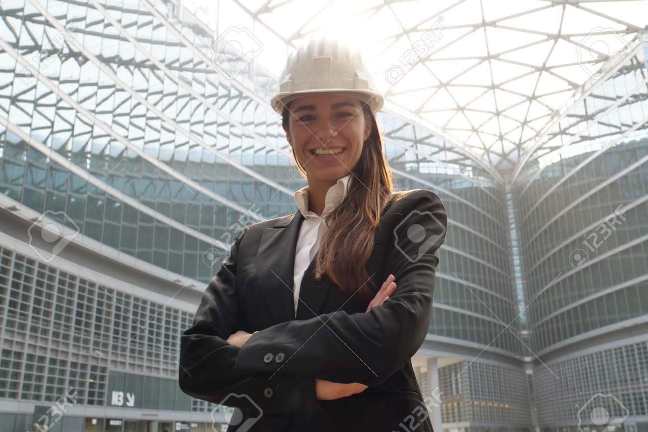 portrait of a female engineer looking at camera and looking at camera. Concept of: design, engineering, work, business. - 112894154