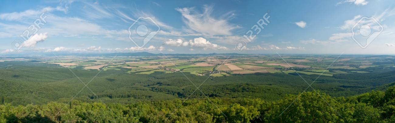 Panorama of forests, meadows and fields under a beautiful sky Stock Photo - 7580084