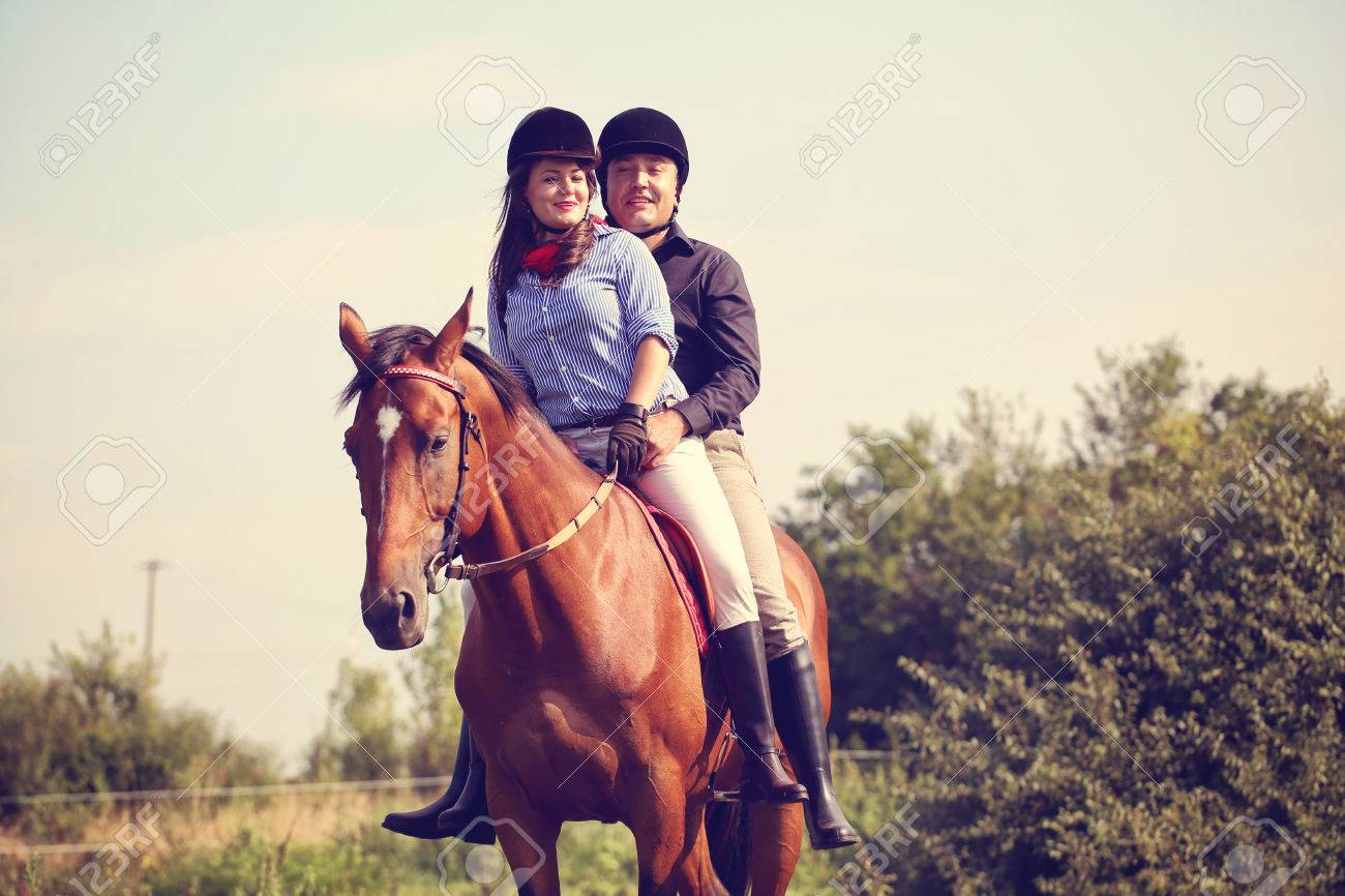 Couple Riding A Horse Stock Photo Picture And Royalty Free Image Image 42378700