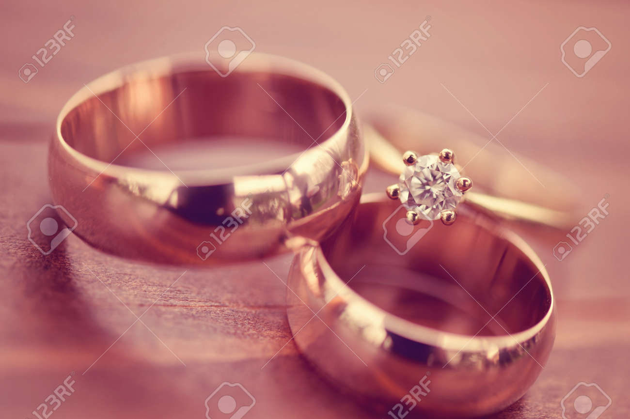 Beautiful Golden Engagement And Wedding Rings Stock Photo, Picture ...