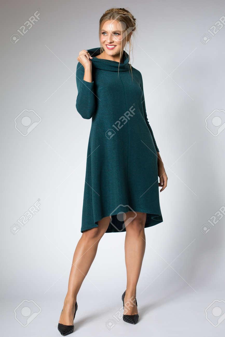 Beautiful girl posing in blue dress - 124727230
