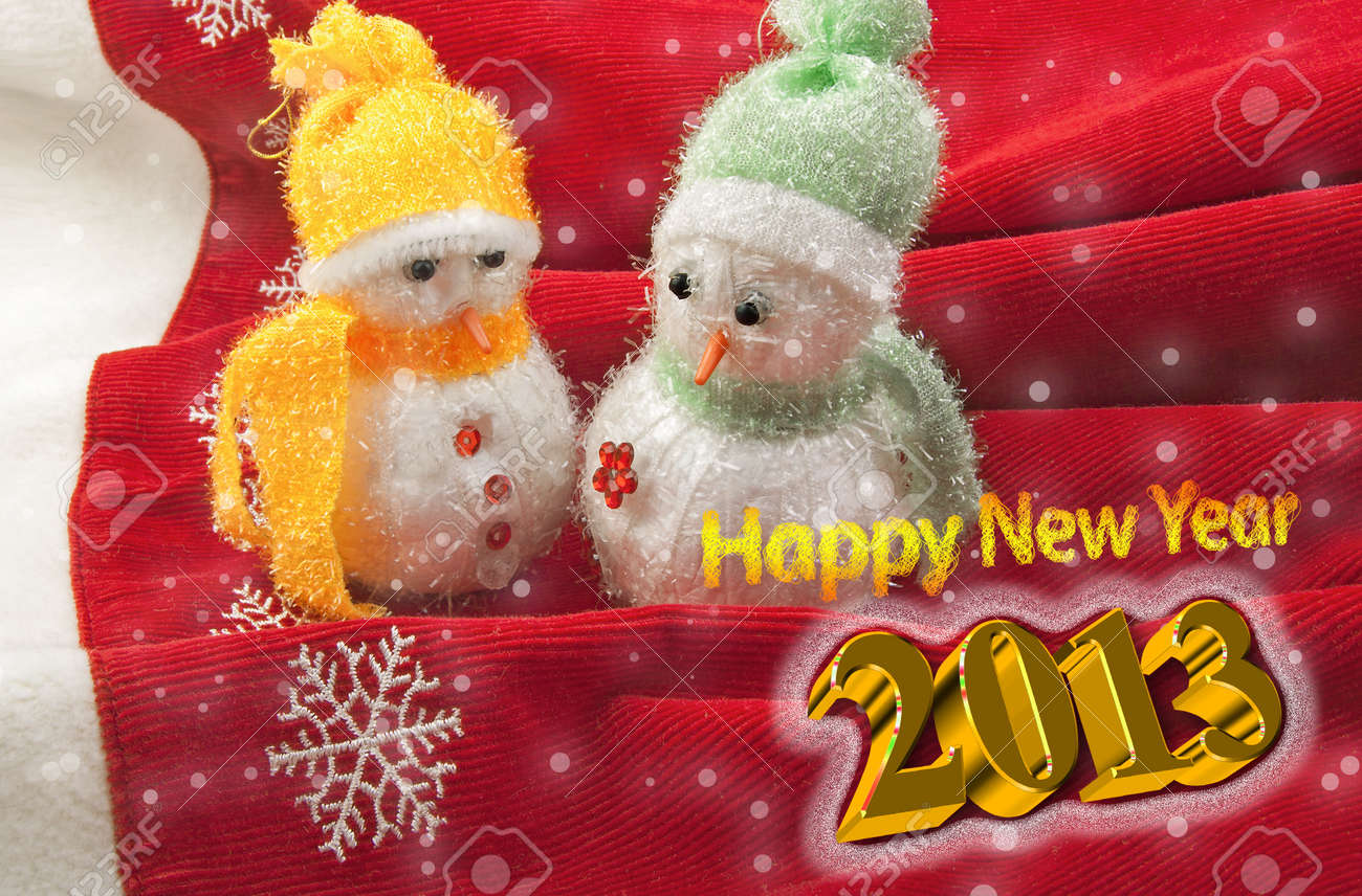 Happy New Year 2013 Greeting Card with two cute little snowmen on a red background with 3D text Stock Photo - 15797140