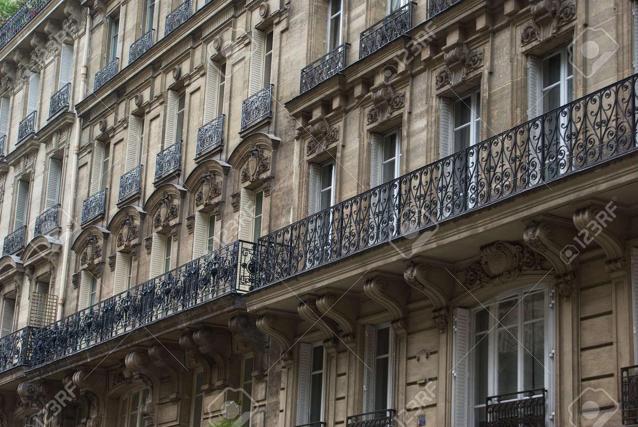 Facade of classic apartment buildings in Paris - 4382613
